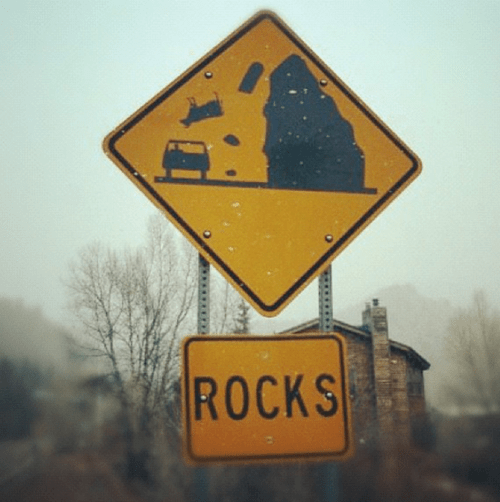 rocks,sign,cow,driving