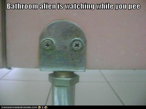 Bathroom alien is watching while you pee