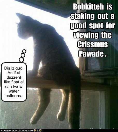 Bobkitteh  is  staking  out  a  good  spot  for  viewing  the  Crissmus  Pawade .