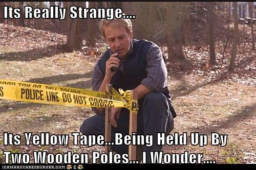 Its Really Strange....  Its Yellow Tape...Being Held Up By Two Wooden Poles... I Wonder....