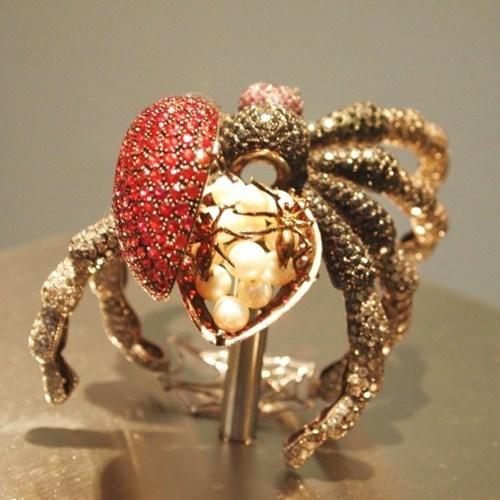 Babies,pearls,jewels,sculpture,creepy,eggs,spider