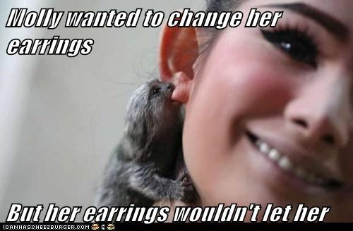 Molly wanted to change her earrings  But her earrings wouldn't let her