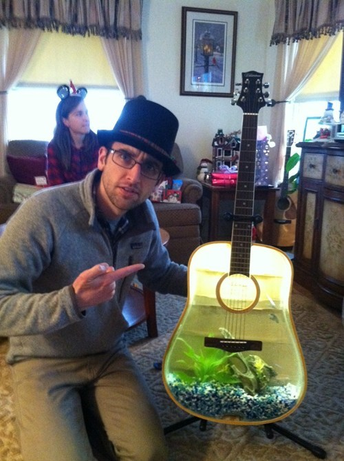 Extra! Extra! Hipster is Confused by Guitar Fish Tank!