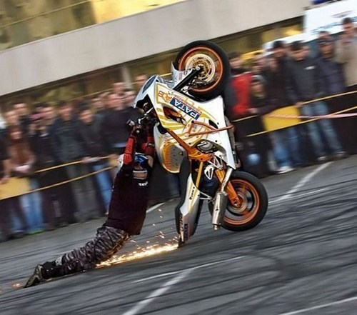 wheelie,cars,sparks,driving,motorcycle