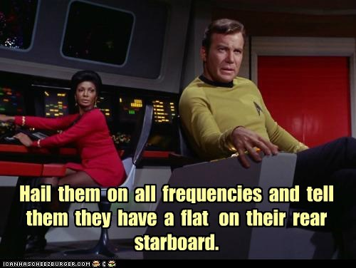 Hail  them  on  all  frequencies  and  tell them  they  have  a  flat   on  their  rear starboard.