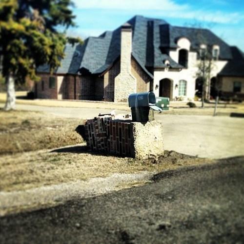 brick post,mailbox,driveway,log