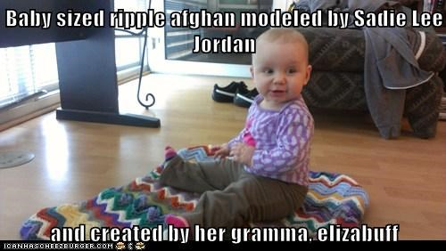 Baby sized ripple afghan modeled by Sadie Lee Jordan  and created by her gramma, elizabuff