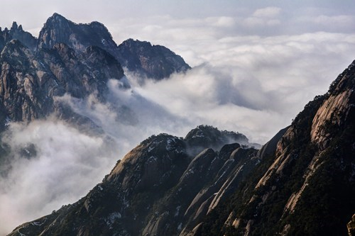 Standing Above the Clouds at Huangshan Mt.
