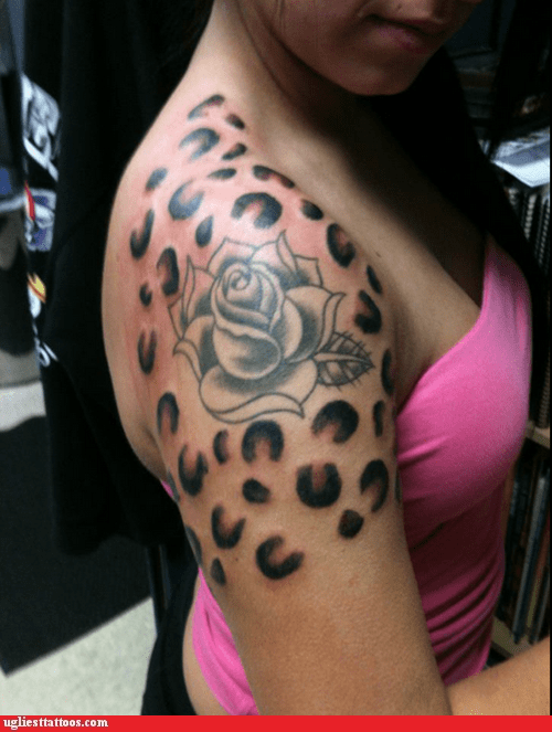 shoulder tattoos,animal prints,roses