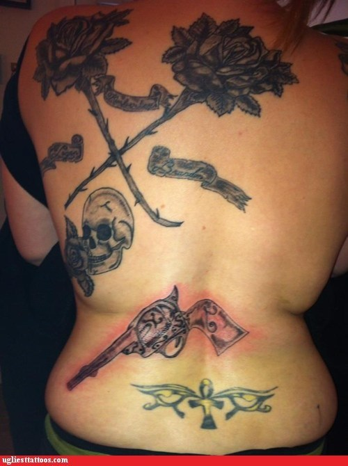 guns,back tattoos,skulls
