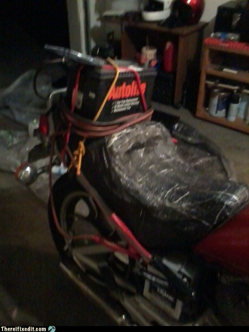 Neighbor Couldn't Get a New Battery for His Bike, So Strapped on a Spare Car Battery to Charge Motorcycle Battery