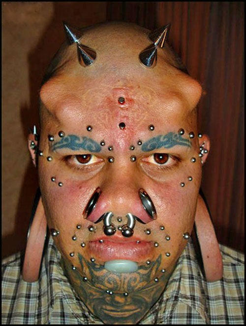 face tattoos,body mods,piercings