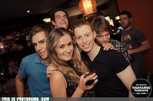 So Much Evil in One Photobomb