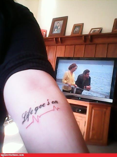 arm tattoos,misspelled tattoos,text tattoos