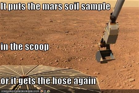 It puts the mars soil sample in the scoop or it gets the hose again