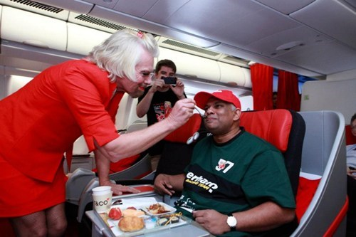 Bazillionaire Richard Branson Loses a Bet, Becomes a Flight Attendant for a Day