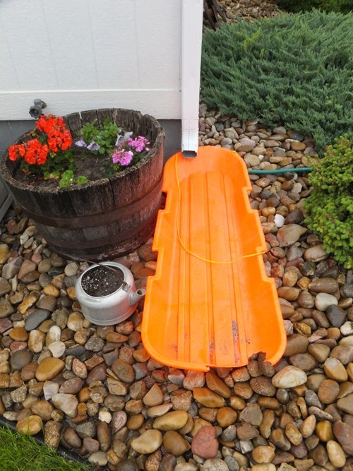 No, Really, I Think The Bright Orange Broken Plastic Sled Really Adds to the Charm