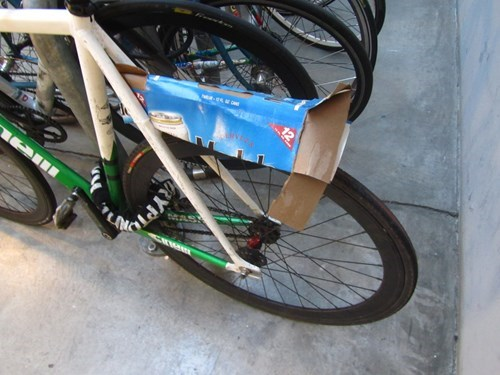 bicycle,bike,cable ties,cardboard,there I fixed it,fender,funny