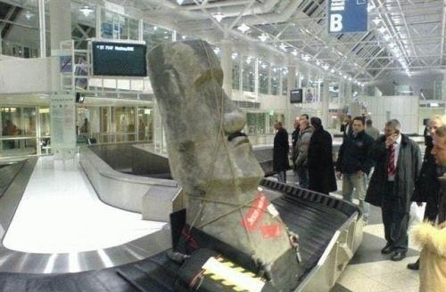 air travel,moai statues,easter island,airports,baggage claim,suitcases,luggage,flying