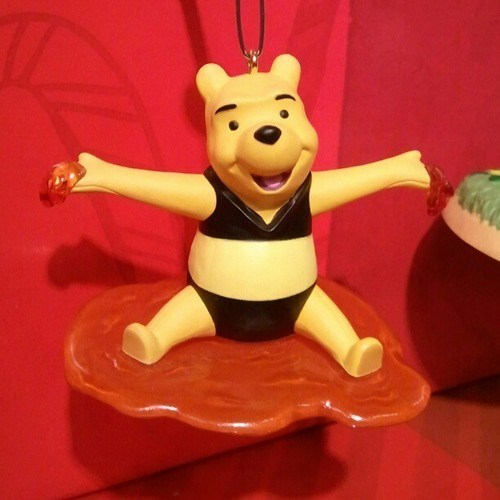 A Winnie the Dressed Un-Seasonably Warm Pooh Ornament