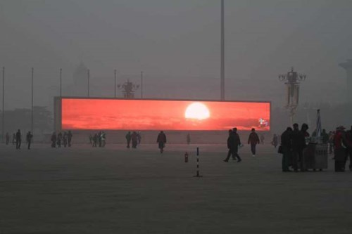 Close Enough of the Day: Smog in Beijing Makes Seeing a Sunrise Only Possible on a Big Screen