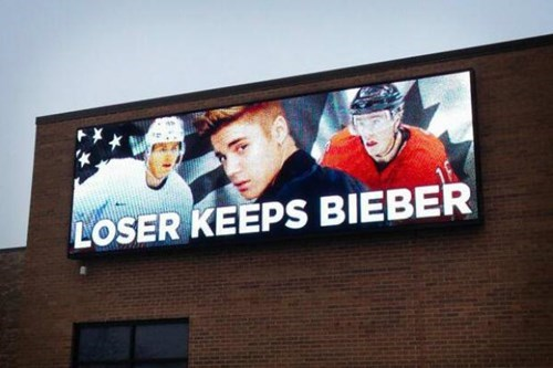 Tomorrow is Canada vs. USA in the Men's Hockey Semifinal. This is a Billboard in Chicago.