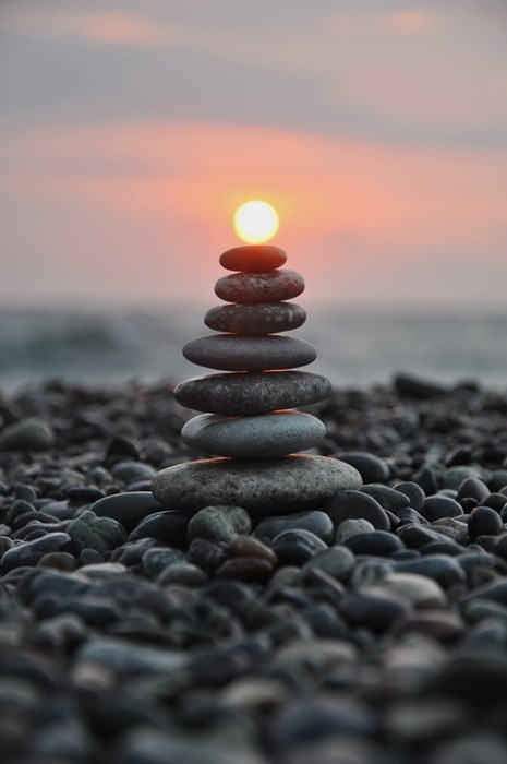 balancing the sun on rocks