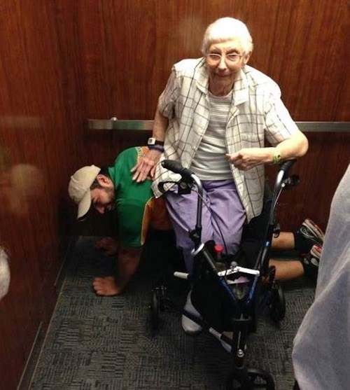 Gracious Act of the Day: Man Lets Elderly Woman Sit on Him Like a Chair While Stuck in an Elevator