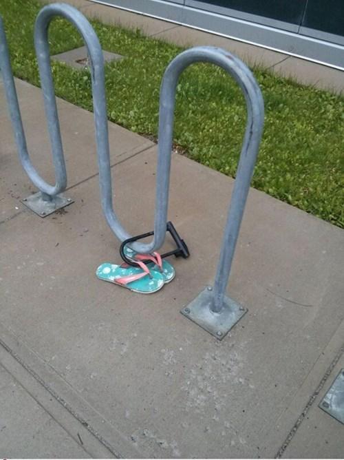 bike lock,bike rack,flip flops,poorly dressed