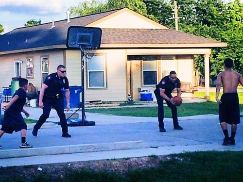 Police Officers Spare a Moment for a Quick Pick-Up Game
