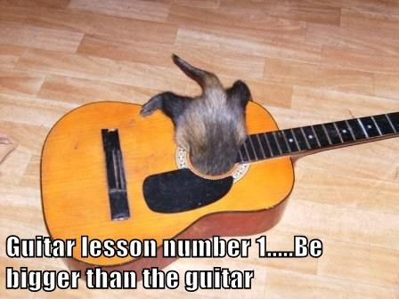 Guitar lesson number 1.....Be bigger than the guitar