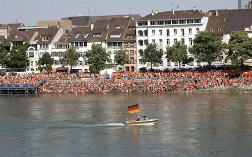 Dutch Fans Are Watching the World Cup on a Big Screen Over the River. Then, All of a Sudden, THIS Guy...
