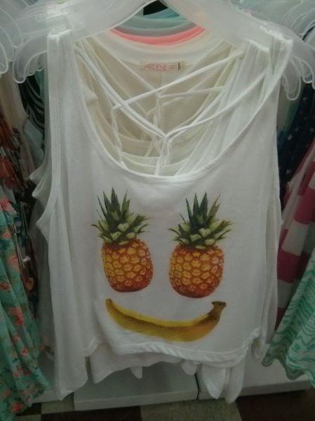 banana,fruit,tank top,pineapple,poorly dressed,smiley face