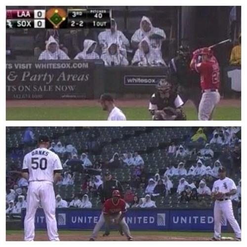 White Sox Pass Out Rain Ponchos to Fans, Awkward Photos Ensue