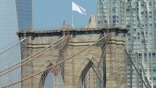 Mystery of the Day: The American Flags Atop the Brooklyn Bridge Were for Some Reason Replaced With White Flags
