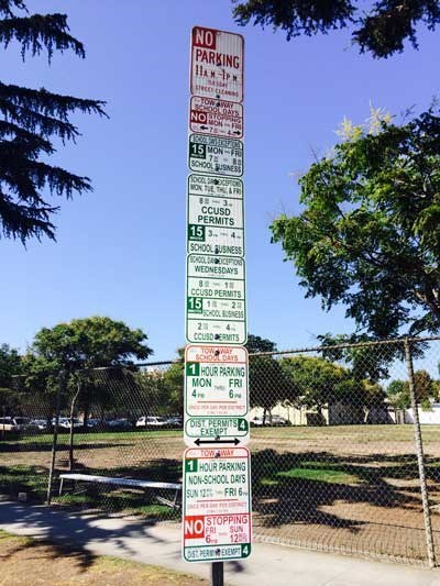 The Parking Sign at a California School is Determined to Reach the Heavens