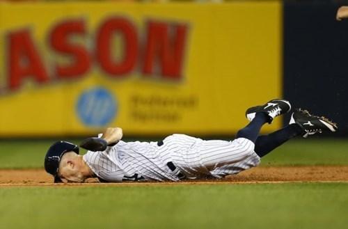 The Yankees' Brett Gardner Eats it as He Slides for Second Base