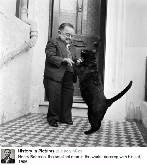 Henry Behrens, the smallest man in the world, dancing with his cat, 1956