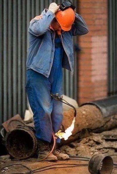 bad idea,helmet,fire,dangerous