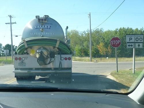 sign,gross,truck,coincidence