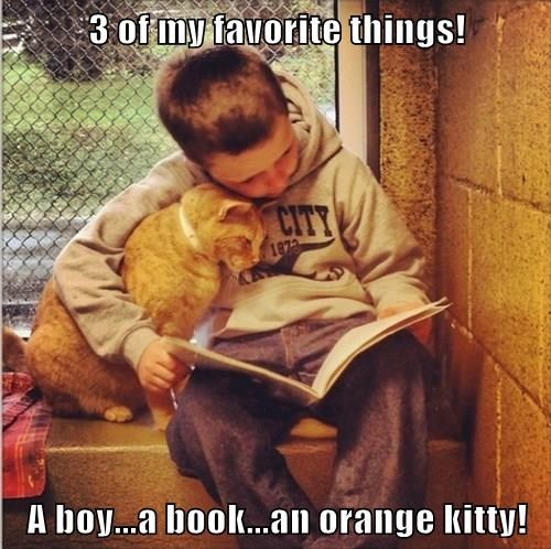 3 of my favorite things!  A boy...a book...an orange kitty!