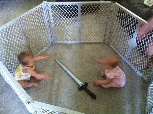 baby,cage match,parenting,sword