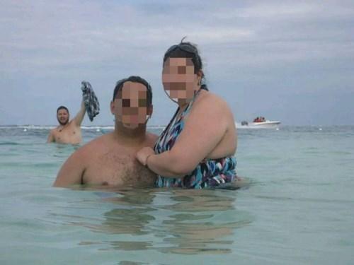 photobomb,poorly dressed,swimming