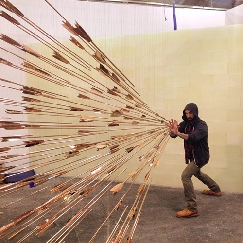 Hundreds of Copper Arrows Point Right at You in This Cool Art Installation