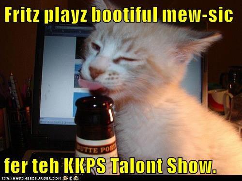 Fritz playz bootiful mew-sic  fer teh KKPS Talont Show.