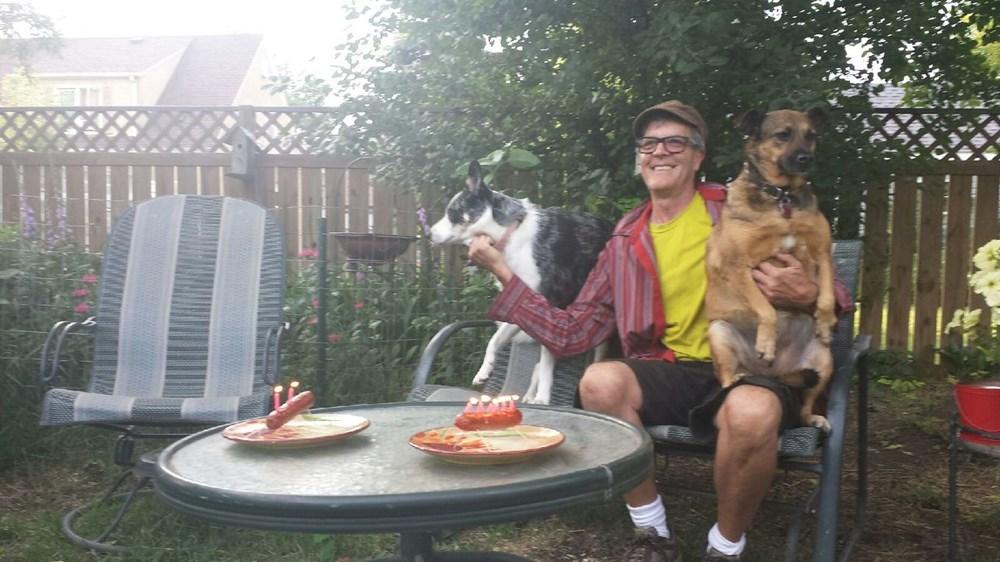 My stepdad celebrating our dogs birthdays.