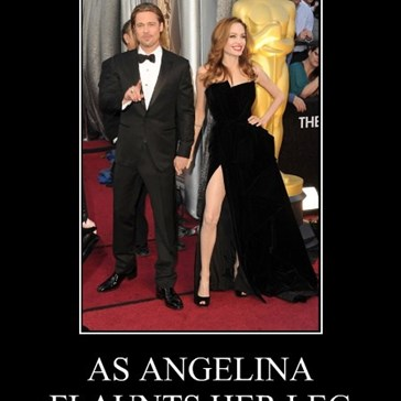 AS ANGELINA FLAUNTS HER LEG