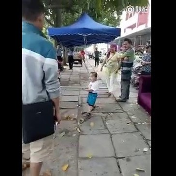 Chinese Toddler Loses All Chill Trying to Defend Grandma from Urban Management Force