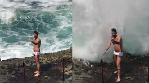 Video of guy trying to take a selfie by the ocean shows what happens when you get too close to big waves.