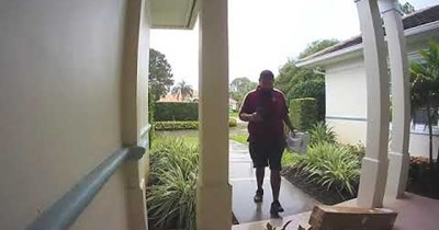 Careless FedEx driver drops package while careful USPS driver takes packages out of the rain